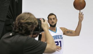 Charlotte Hornets' Marco Belinelli poses for a photo during the NBA basketball team's media day in Charlotte, N.C., Monday, Sept. 26, 2016. (AP Photo/Chuck Burton)