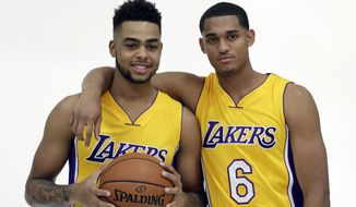 Los Angeles Lakers' D'Angelo Russell, left, poses with with Jordan Clarkson (6) during the team's NBA basketball media day in El Segundo, Calif., Monday, Sept. 26, 2016. (AP Photo/Nick Ut)
