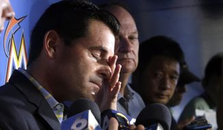 Miami Marlins president David Samson wipes a tear as he talks about Miami Marlins pitcher Jose Fernandez before a baseball game between the Marlins and the New York Mets, Monday, Sept. 26, 2016, in Miami. Fernandez was killed in a boating accident early Sunday. (AP Photo/Lynne Sladky)