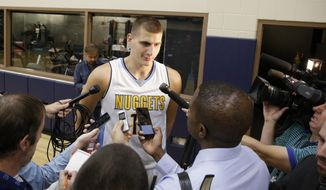 Denver Nuggets center Nikola Jokic talks to reporters during the NBA basketball team's media day, Monday, Sept. 26, 2016, in Denver. (AP Photo/Jack Dempsey)