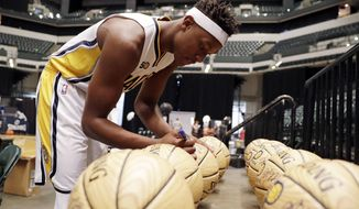 Indiana Pacers' Myles Turner signs autographs during an NBA basketball media day, Monday, Sept. 26, 2016, in Indianapolis. (AP Photo/Darron Cummings)