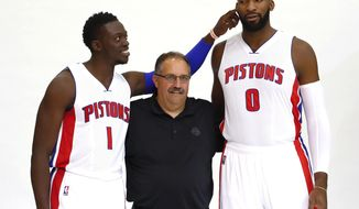 Detroit Pistons' Reggie Jackson (1) teases Andre Drummond (0) while posing with coach Stan Van Gundy during the NBA basketball team's media day in Auburn Hills, Mich., Monday, Sept. 26, 2016. (AP Photo/Paul Sancya)