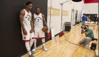 Toronto Raptors' DeMar DeRozan, left, and Kyle Lowry pose for a photoshoot during a media day for the NBA basketball team in Toronto, Monday, Sept. 26, 2016. (Chris Young/The Canadian Press via AP)