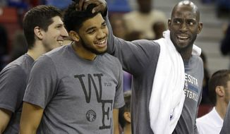 FILE - In this Nov. 27, 2015, file photo, Minnesota Timberwolves forward Kevin Garnett, right, rubs the head of teammate Karl-Anthony Towns as they celebrate during the closing moments of the Timberwolves' 101-91 win over the Sacramento Kings in an NBA basketball game in Sacramento, Calif. The Timberwolves held their annual media day on Monday, Sept. 26, 2016, one day before they are set to open training camp. Players were preparing for life without franchise icon Garnett, who announced his retirement on Friday, Sept. 23, 2016. (AP Photo/Rich Pedroncelli, File)