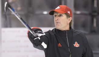 Team Canada head coach Mike Babcock gestures during practice at the World Cup of Hockey in Toronto on Friday, Sept. 23, 2016. (Chris Young/The Canadian Press via AP)