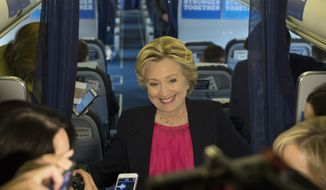 Democratic presidential candidate Hillary Clinton speaks with members of the media on board her campaign plane at Westchester County Airport in White Plains, N.Y., Tuesday, Sept. 27, 2016. (AP Photo/Matt Rourke)