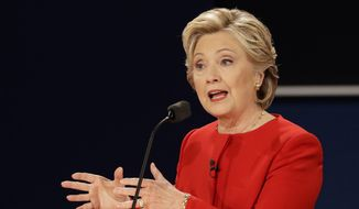Democratic presidential nominee Hillary Clinton answers a question during the presidential debate with Republican presidential nominee Donald Trump at Hofstra University in Hempstead, N.Y., Monday, Sept. 26, 2016. (AP Photo/David Goldman)