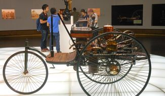 The Mercedes-Benz Museum in Stuttgart, Germany, displays an early, three-wheeled version of the automobile.