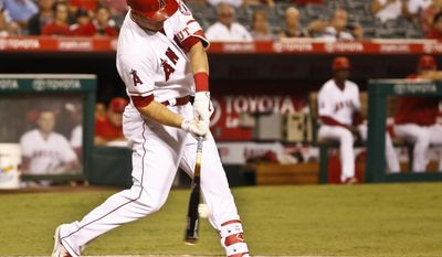 Los Angeles Angels' Mike Trout swings for a base hit against the Oakland Athletics during the first inning of baseball game Monday, Sept. 26, 2016, in Anaheim, Calif. (AP Photo/Lenny Ignelzi)