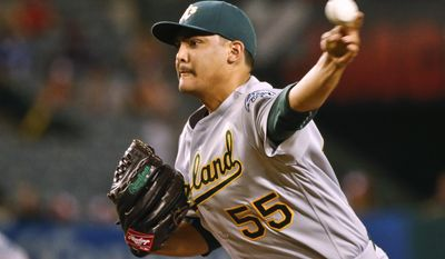 Oakland Athletics starting pitcher Sean Manaea works against the Los Angeles Angels during the first inning of baseball game Monday, Sept. 26, 2016, in Anaheim, Calif. (AP Photo/Lenny Ignelzi)