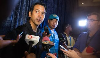 Miami Heat head basketball coach Erik Spoelstra talks to the press at the team's training camp in Nassau, Bahamas, Tuesday, Sept 27, 2016. The team arrived in the Bahamas Monday for a week-long training session at Atlantis, Paradise Island. (AP Photo/Tim Aylen)