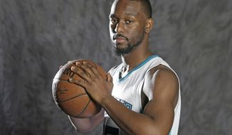 In this photo taken Sept. 26, 2016, Charlotte Hornets' Kemba Walker poses for a photo during the NBA basketball team's media day in Charlotte, N.C. Walker has been on the verge of becoming an NBA All-Star. Nicolas Batum and other teammates believe this will be the year the sixth-year pro finally breaks through. (AP Photo/Chuck Burton)