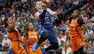 FILE - In this Sept. 4, 2016, file photo, Minnesota Lynx's Lindsay Whalen (13) jumps to the basket past the Connecticut Sun defense during the second half of a WNBA basketball game,in Minneapolis. Whalen's decision to forego the riches of playing overseas to rest her body for the WNBA season has paid off. After watching her play so well to lead the Lynx to the No. 1 seed in the playoffs this season, some of her veteran teammates have decided to follow her lead.  (AP Photo/Stacy Bengs, File)