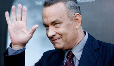 """FILE - In this Sept. 8, 2016, file photo, Tom Hanks arrives at the LA Premiere of """"Sully"""" at The Directors Guild of America Theater in Los Angeles. Hanks stopped to crash the wedding day photo shoot of a couple in New York's Central Park over the weekend. He posted a selfie he took with the bride and groom on Instagram Sunday, Sept. 25, 2016. (Photo by Rich Fury/Invision/AP, File)"""