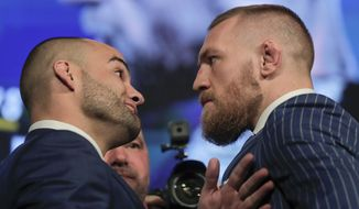 UFC lightweight champion Eddie Alvarez, left, and featherweight champion Connor McGregor, right, pose for photos during a new conference for UFC 205, Tuesday, Sept. 27, 2016, in New York. McGregor and Alvarez will headline the first UFC card to be held in the state since the state legislature legalized the sport earlier this year. UFC 205 is scheduled for Nov. 12. (AP Photo/Julie Jacobson)