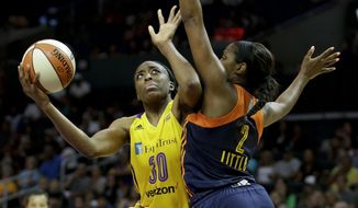 FILE - In this June 26, 2016, file photo, Los Angeles Sparks forward Nneka Ogwumike, left, shoots over Connecticut Sun forward Camille Little during the second half of an WNBA basketball game in Los Angeles. Ogwumike is the WNBA Most Valuable Player, the league announced, Tuesday, Sept. 27, 2016. (AP Photo/Chris Carlson, File)