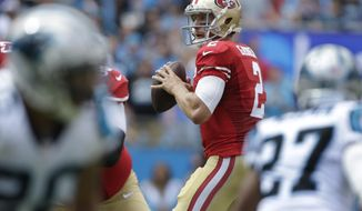 FILE - In this Sept. 18, 2016, file photo, San Francisco 49ers quarterback Blaine Gabbert looks to pass against the Carolina Panthers during an NFL football game in Charlotte, N.C. Gabbert has struggled to get the ball downfield for San Francisco this season, especially on third downs. (AP Photo/Bob Leverone, File)
