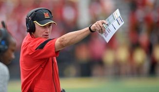 Known for his defensive prowess, first-year coach DJ Durkin has led Maryland to an undefeated start with an offense that is averaging 266.7 yards rushing and has scored 123 points, second-most in school history after three games. Quarterback Perry Hills (below) has completed 62 percent of his passes, three for touchdowns. (Associated Press Photographs)
