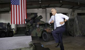 President Obama jumps up the stairs to take the stage to speak to members of the military community Wednesday at Fort Lee in Virginia. (Associated Press)
