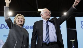 Democratic presidential candidate Hillary Clinton and Sen. Bernie Sanders, I-Vt., take the stage during a campaign stop at the University Of New Hampshire in Durham, N.H., Wednesday, Sept. 28, 2016. (AP Photo/Matt Rourke)