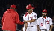 Washington Nationals starting pitcher Gio Gonzalez hands the ball to manager Dusty Baker, left, during the fourth inning of a baseball game against the Arizona Diamondbacks in Washington, Wednesday, Sept. 28, 2016. (AP Photo/Manuel Balce Ceneta)