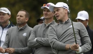 Europe's Danny Willett watches his drive with teammate Europe's Justin Rose and Europe's Sergio Garcia during a practice round for the Ryder Cup golf tournament Wednesday, Sept. 28, 2016, at Hazeltine National Golf Club in Chaska, Minn. (AP Photo/Chris Carlson)