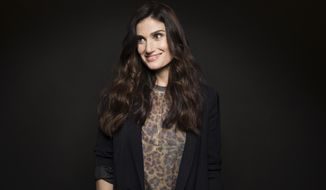 "Idina Menzel poses for a portrait on Wednesday, Sept. 21, 2016, in New York. Broadway and ""Frozen"" star Menzel released a new introspective album on Friday after a tumultuous few years, and its simple title ""idina."" is as stripped-down and honest as it gets. (Photo by Taylor Jewell/Invision/AP)"