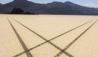 FILE - This Aug. 26, 2016 file photo provided by the National Park Service shows tire tracks made by a vehicle illegally crossing the Racetrack Playa at Death Valley National Park, Calif. Federal investigators have identified a motorist suspected of taking the illegal joyride on the dry lake bed in Death Valley National Park, leaving 10 miles of swerving tire tracks. Officials have not released the suspect's name. (National Park Service via AP,File)