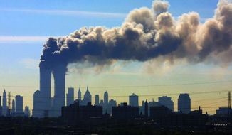FILE - In this Sept. 11, 2001 file photo, as seen from the New Jersey Turnpike near Kearny, N.J., smoke billows from the twin towers of the World Trade Center in New York after airplanes crashed into both towers. Saudi Arabia and its allies are warning that legislation allowing the kingdom to be sued for the 9/11 attacks will have negative repercussions. The kingdom maintains an arsenal of tools to retaliate with, including curtailing official contacts, pulling billions of dollars from the U.S. economy, and enlisting its lockstep Gulf allies to scale back counterterrorism cooperation, investments and U.S. access to important regional air bases. (AP Photo/Gene Boyars, File)