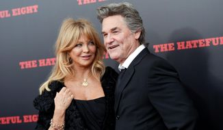 "FILE - In this Dec. 14, 2015, file photo, actors Goldie Hawn and Kurt Russell attend the premiere of ""The Hateful Eight"" at the Ziegfeld Theatre in New York. Hawn tells British chat show ""Loose Women"" that she ""would have been long divorced"" is she had gotten married. (Photo by Evan Agostini/Invision/AP, File)"