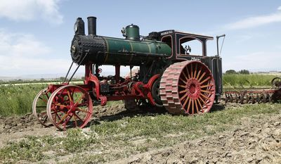 This July 19, 2016 photo shows a 1910 Avery steam engine tractor owned by Keith Murray of Murraymere Farms near Powell, Wyo.    The huge tractor was one of several historical demonstrations at an event at the University of Wyoming's Powell Research and Extension Center.   (Ilene Olson/The Powell Tribune via AP)