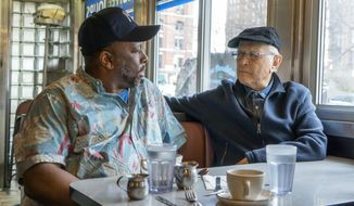 "This image released by Epix shows Rob Robinson, left, with producer Norman Lear in a scene from the documentary, ""America Divided.""  The five-week docuseries, which premieres Friday at 9 p.m. EDT on Epix. (Nicole Rivelli/Epix via AP)"
