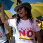 """Demonstrators yell, """"No to the plebiscite,"""" to protest the government's peace agreement with the Revolutionary Armed Forces of Colombia, which has been involved in a half-century of warfare that has caused more than 200,000 casualties. (Associated Press)"""
