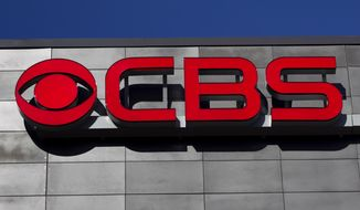 FILE - In this Feb. 13, 2012, file photo, a CBS logo is displayed on the exterior of CBS Scene Restaurant and Bar, at Gillette Stadium, in Foxborough, Mass. On Thursday, Sept. 29, 2016, National Amusements, the company that controls CBS and Viacom, announced it wants the two media companies to combine again, more than a decade after they went their separate ways. CBS Corp. produces TV shows and owns its namesake network. Viacom Inc. owns cable channels MTV, Nickelodeon and VH1. (AP Photo/Steven Senne, File)