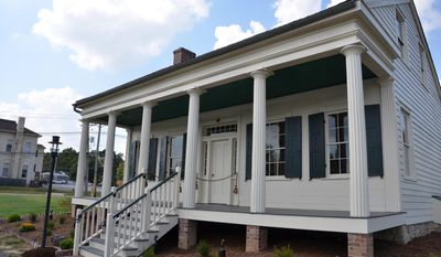 ADVANCE FOR USE SUNDAY, OCT 2, 2016 AND THEREAFTER - This Sept. 24, 2016 photo shows the D.D. Collins House which reopened in its new location in Collins Park on Sept. 24, 2016, in Collinsville, Ill. An 18-year restoration effort and 171 years after its construction, the residence of Collinsville's first  mayor, can be to toured. (Elizabeth Donald/Belleville News-Democrat, via AP)