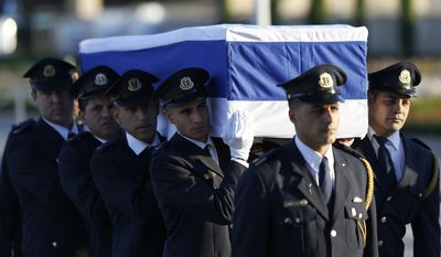 Members of the Knesset guard carry the coffin of former Israeli President Shimon Peres at the Knesset, Israel's Parliament, in Jerusalem, Thursday, Sept. 29, 2016. Peres died early Wednesday from complications from a stroke. He was 93. (AP Photo/Ariel Schalit)