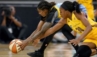Los Angeles Sparks' Nneka Ogwumike (30) dives for a loose ball with Chicago Sky's Jessica Breland during the first half of Game 1 of a WBNA basketball semifinal in Long Beach, Calif, Wednesday, Sept. 28, 2016. (AP Photo/Michael Owen Baker)