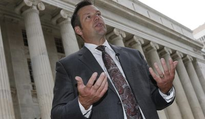 FILE - In this Aug. 23, 2016 file photo, Kansas Secretary of State Kris Kobach responds to questions outside the 10th U.S. Circuit Court of Appeals in Denver. A federal judge canceled a contempt hearing for Kobach after he agreed Thursday, Sept. 29, 2016, to concessions that will fully register and clearly notify thousands of people that they can vote in November.The ruling by U.S. District Judge Julie Robinson comes a day before a hearing had been scheduled for Kobach to show why he should not be held in contempt for allegedly violating her May order. (AP Photo/David Zalubowski)