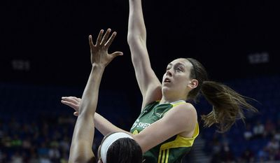 FILE - In this June 10, 2016, file photo, Seattle Storm's Breanna Stewart shoots over Connecticut Sun's Morgan Tuck during the second half of a WNBA basketball game in Uncasville, Conn. Stewart is the WNBA rookie of the year. The league announced Thursday, Sept. 29, 2016, that Stewart received 38 of the 39 votes from a national media panel. (AP Photo/Jessica Hill, File)