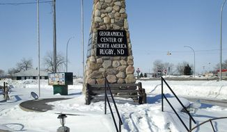 FILE - In this March 1, 2010 file photo, a twenty one foot tall obelisk marks the spot the town of Rugby says is the Geographic center of North America, in Rugby N.D. The town built the obelisk in 1932 and has trademarked the title. Hanson's Bar in Robinson is now touting its continental bull's-eye status after snatching the title from the nearby city of Rugby that allowed its trademark to lapse. (AP Photo/Will Kincaid, File)