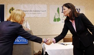Candidates for U.S. Senate, Democrat Gov. Maggie Hassan, left, and incumbent Republican U.S. Sen. Kelly Ayotte shake hands before the start of their first debate Friday, Sept. 30, 2016, in Conway, N.H. (AP Photo/Jim Cole)