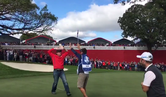 David Johnson celebrates a made putt after accepting a challenge from Team Europe during a Ryder Cup practice round at Hazeltine National Golf Club in Chaska, Minnesota, on Sept. 29. Johnson, a spectator in the gallery, was challenged after heckling several golfers.