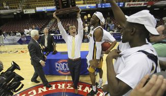 FILE - In this March 7, 2016, file photo, Chattanooga head coach Matt McCall celebrates with his team after winning the Southern Conference men's basketball championship in an NCAA college basketball game against East Tennessee State University in Asheville, N.C. The Southern Conference will keep four league championships in North Carolina despite the NCAA and the ACC withdrawing championships because of the state law restricting rights of LGBT people. The championships are: men's soccer in Greensboro, men's and women's basketball in Asheville and men's golf in Pinehurst.  (AP Photo/Ben Earp, File)