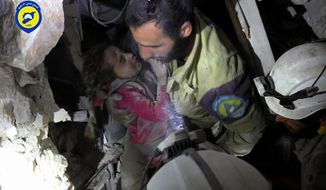 In this Wednesday, Sept. 28, 2016, photo provided by the Syrian Civil Defense group known as the White Helmets, shows a Civil Defense worker carrying the survived child Ghazal Akhtarini, from under the rubles after airstrikes hit al-Shaar neighborhood in Aleppo, Syria. Nearly 100 children were killed in a single week in Aleppo as Syrian and Russian warplanes sought to bombard into submission the rebel eastern districts of the city that have held out against Syrian government forces for five years. Without hope for the future, no regular schooling and little access to nutritious food, the children of Aleppo and their parents struggle to survive and fear the threat an imminent ground offensive. (Syrian Civil Defense White Helmets via AP)