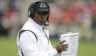FILE - In this Oct. 31, 2015, file photo Purdue coach Darrell Hazell stands on the sideline during the team's NCAA college football game against Nebraska in West Lafayette, Ind. Purdue faces Maryland on Saturday, Oct. 1, 2016.  (AP Photo/Michael Conroy, File)