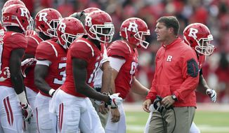 FILE - In this Sept. 17, 2016, file photo, Rutgers head coach Chris Ash shouts to his players during the second half of a NCAA college football game against New Mexico in Piscataway, N.J. Ash brings his team to Columbus Saturday to play No. 2 Ohio State for the first time since he helped run the Buckeyes defense and coached safeties during the national championship run in 2014 and last season. (AP Photo/Mel Evans, File)