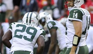 FILE - In this Sunday, Sept. 25, 2016, file photo, New York Jets quarterback Ryan Fitzpatrick (14) walks to the line of scrimmage during the second half of an NFL football game against the Kansas City Chiefs in Kansas City, Mo. Carroll and the Seattle Seahawks watched the Jets' ugly game film from last week, when Ryan Fitzpatrick kept throwing the ball to the other team. One interception after the other _ six in all for the New York quarterback. Carroll's not expecting anything close to that type of slopfest on Sunday when the Seahawks (2-1) take on the Jets (1-2). (AP Photo/Ed Zurga, File)