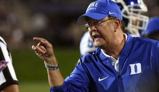 FILE - In this Sept. 17 2016 file photo, Duke head coach David Cutcliffe argues the incomplete pass call after Northwestern cornerback Montre Hartage (24) broke up a pass in the end zone thrown to Duke wide receiver Anthony Nash (83) during the second half of an NCAA college football game in Evanston, Ill. Duke and Virginia are both looking to pick up some semblance of momentum this week. The Blue Devils and Cavaliers pulled off impressive upset victories last week and meet Saturday in a deceptively important game that could put the loser into a substantial hole in the Coastal Division standings.  (AP Photo/Matt Marton, File)