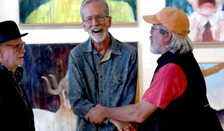 ADVANCED FOR RELEASE SATURDAY, OCTOBER 1, 2016 Art Spirit Gallery owner Steve Gibbs, center, shares a laugh with John Thamm, left and Mark Johnstone during a Mel McCuddin opening at the gallery in Coeur d'Alene, Idaho, Sept. 9, 2016. (Kathy Plonka/The Spokesman-Review via AP)