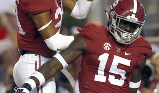 Alabama defensive back Minkah Fitzpatrick (29) celebrates with defensive back Ronnie Harrison (15) after scoring on a fumble recovery against Kentucky during the first half of an NCAA college football game, Saturday, Oct. 1, 2016, in Tuscaloosa, Ala. (AP Photo/Butch Dill)